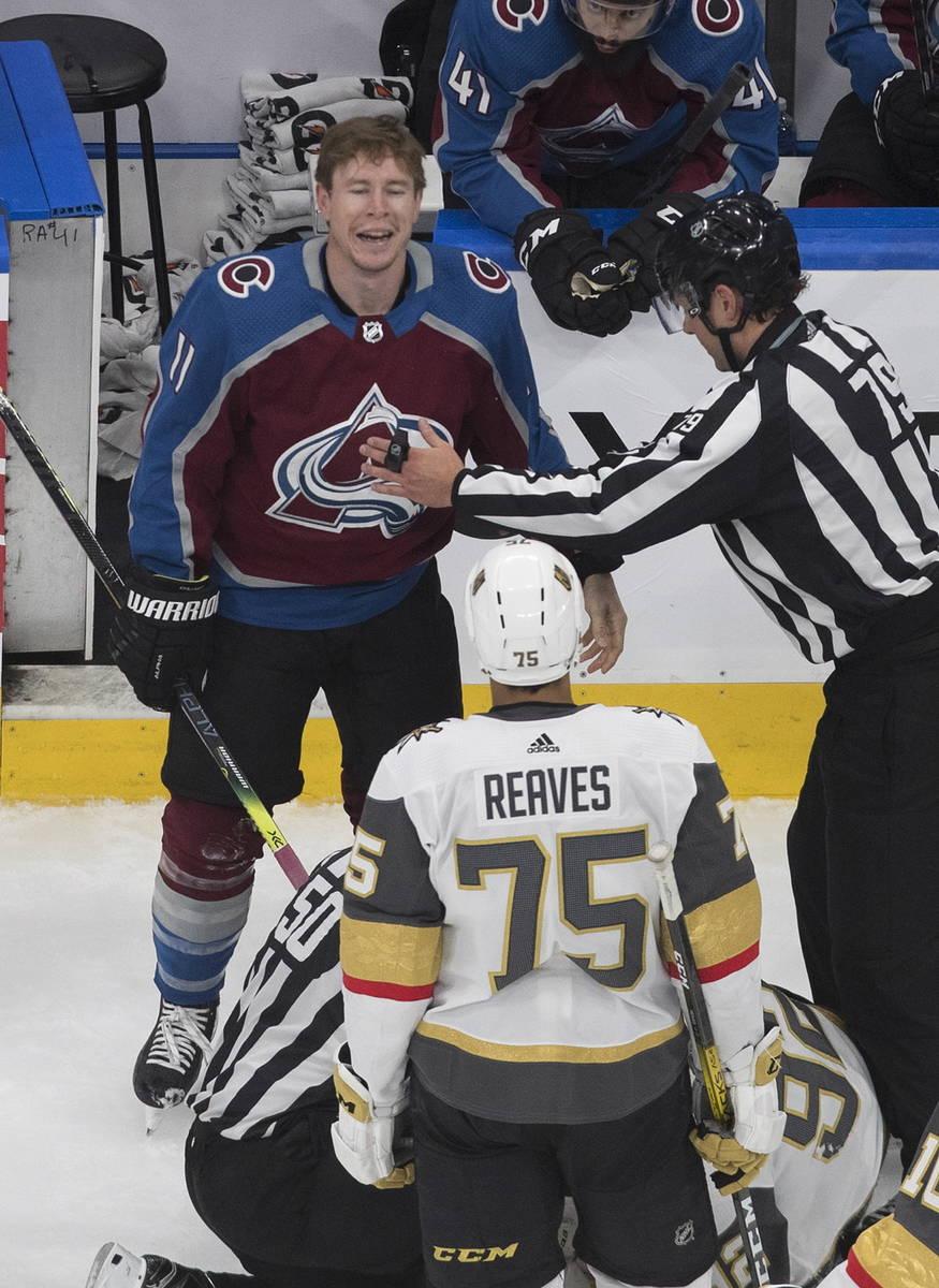 Colorado Avalanche's Matt Calvert (11) and Vegas Golden Knights' Ryan Reaves (75) exchange word ...