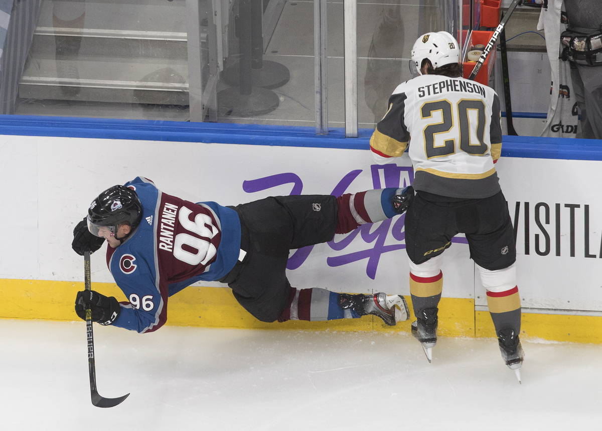 Colorado Avalanche's Mikko Rantanen (96) is checked by Vegas Golden Knights' Chandler Stephenso ...