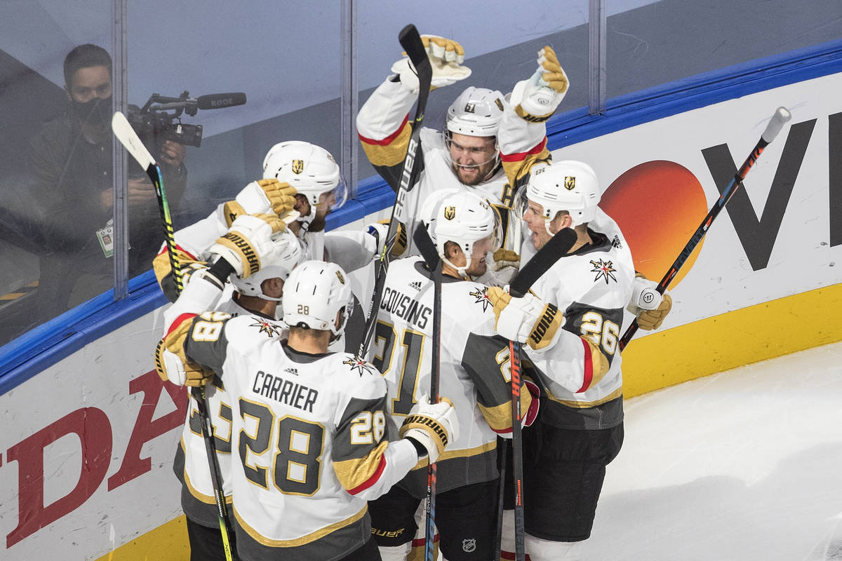Vegas Golden Knights celebrate the team's overtime win over the Colorado Avalanche in an NHL ho ...