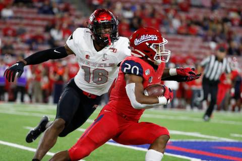 UNLV linebacker Javin White tries to stop Fresno State running back Ronnie Rivers during the fi ...