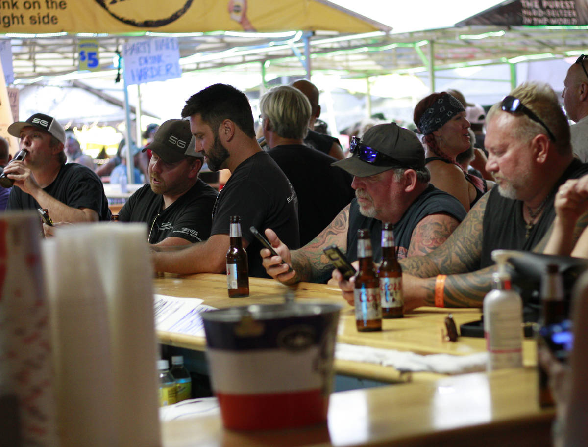 People crowded around bars in Sturgis, S.D., on Friday, Aug. 7, 2020 during the 80th anniversar ...