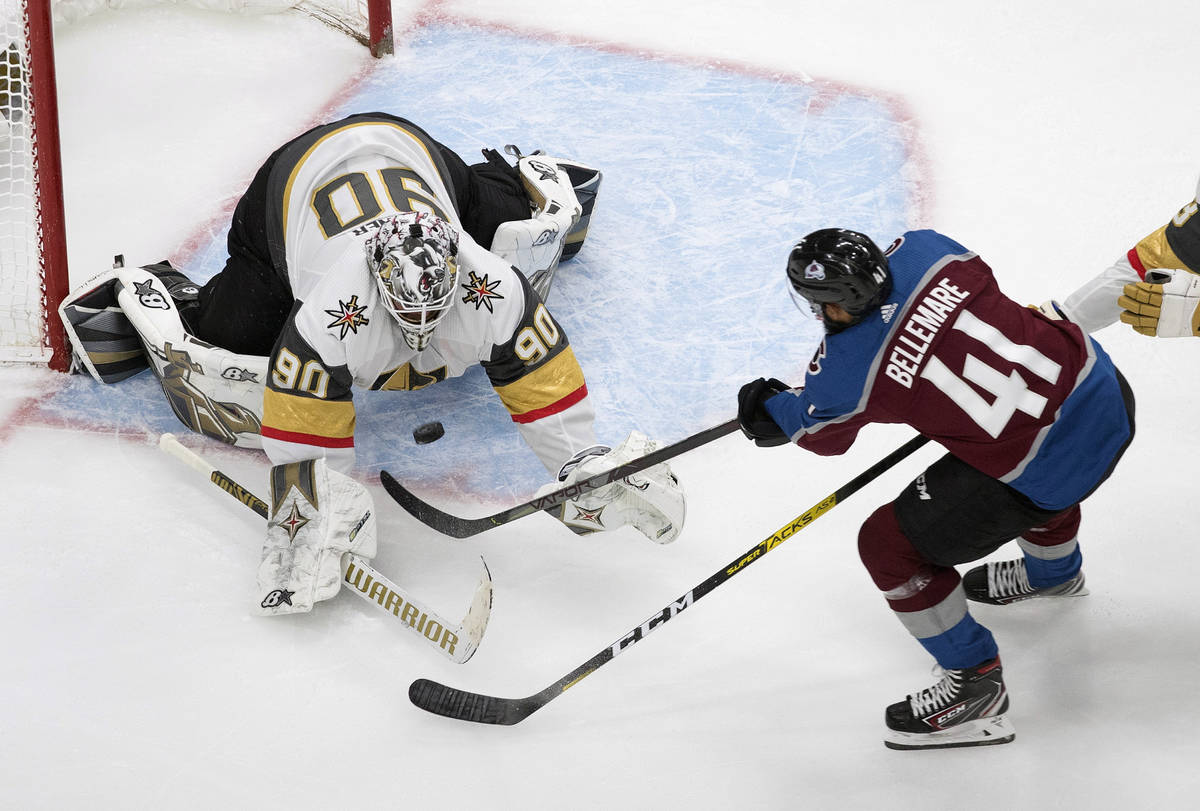 Colorado Avalanche's Pierre-Edouard Bellemare (41) is stopped by Vegas Golden Knights goalie Ro ...