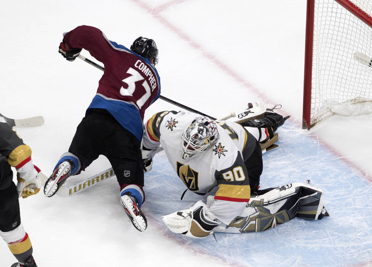Colorado Avalanche's J.T. Compher (37) scores on Vegas Golden Knights goalie Robin Lehner (90) ...