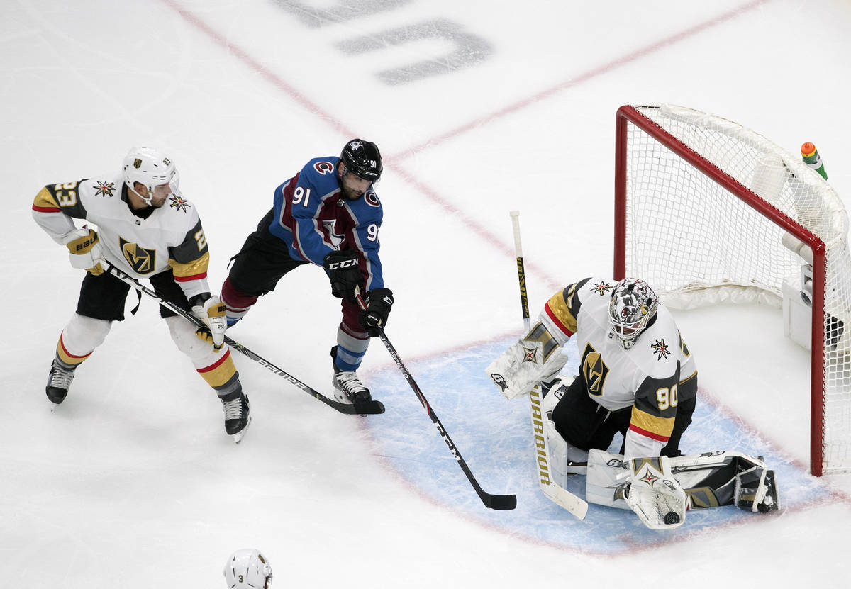 Colorado Avalanche's Nazem Kadri (91) is stopped by Vegas Golden Knights goalie Robin Lehner (9 ...