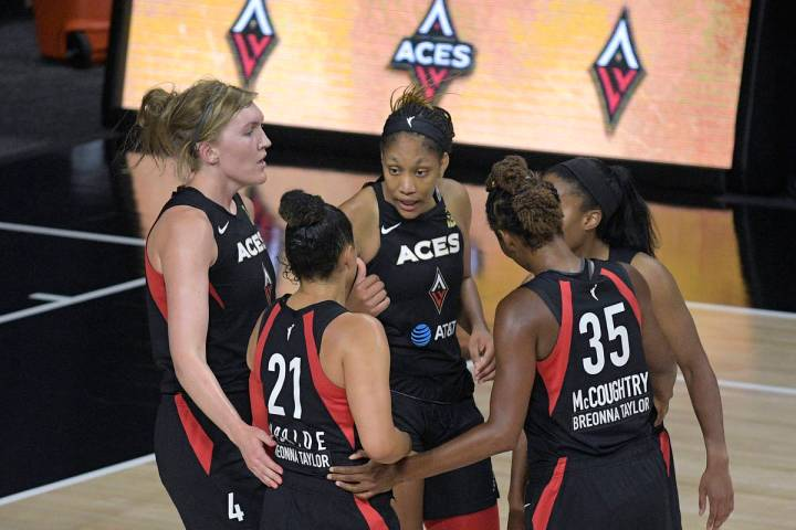 Las Vegas Aces players huddle on the court during the second half of a WNBA basketball game aga ...