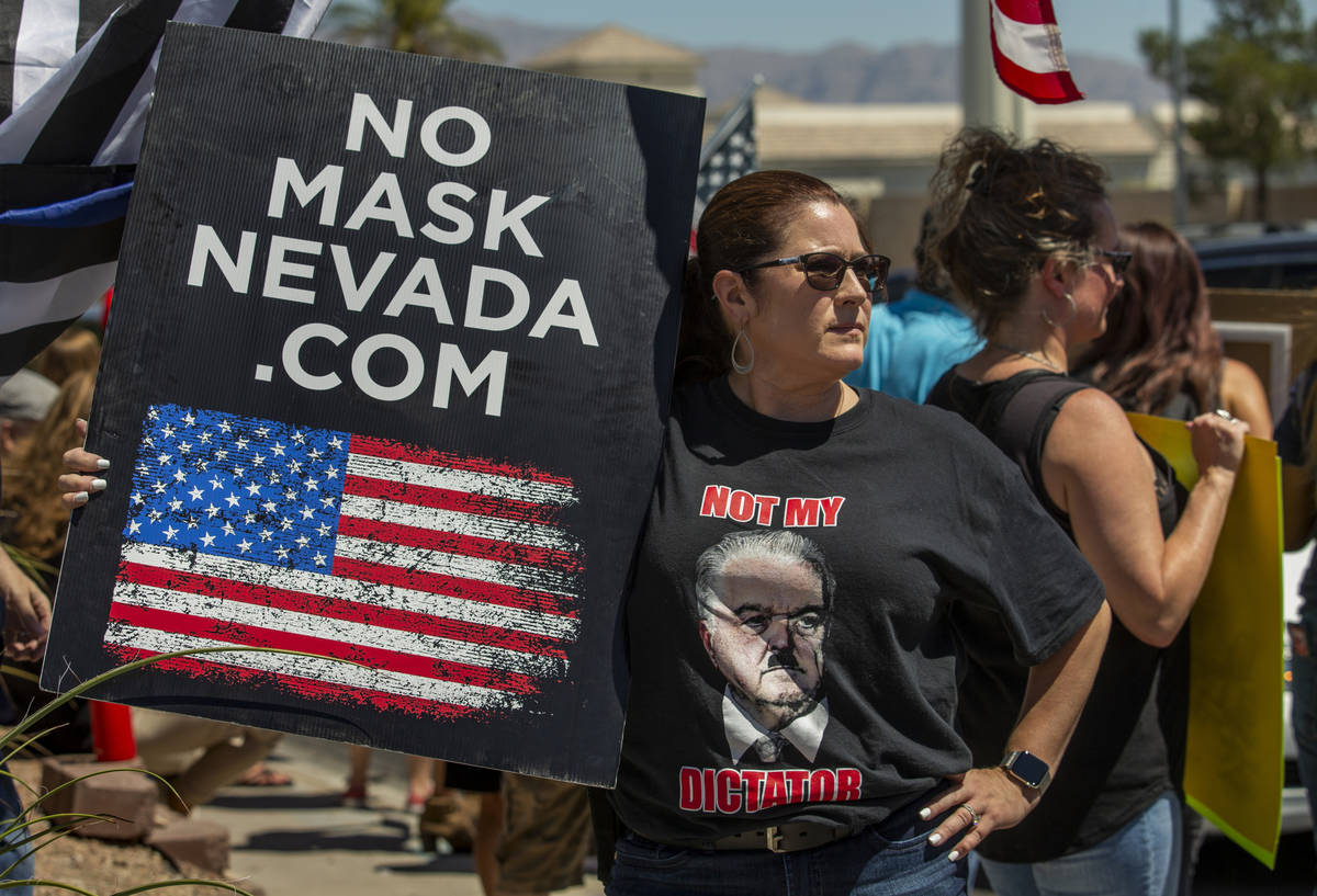 Organizer Melissa Blundo looks on during another No Mask Nevada rally to oppose the face mask m ...