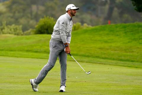 Dustin Johnson hits from the fairway on the 18th hole during the third round of the PGA Champio ...