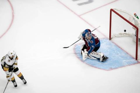 Colorado Avalanche goalie Philipp Grubauer (31) is scored against by Vegas Golden Knights' Jona ...