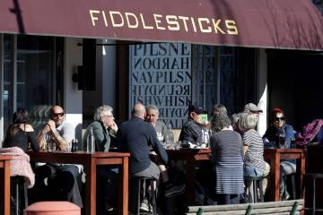 Customers at a cafe enjoy lunch in the sunshine in Christchurch, New Zealand, Sunday, Aug. 9, 2 ...