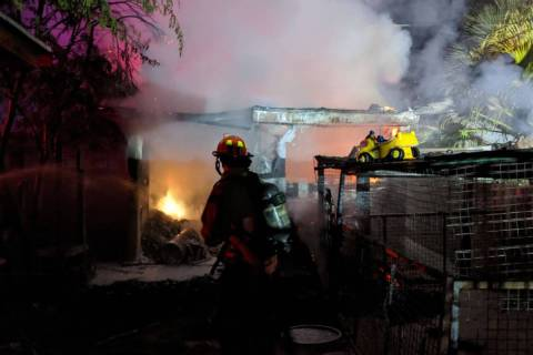 Crews battle a shed fire Sunday, Aug. 9, 2020, on the 3400 block of Navajo Way in Las Vegas. (L ...