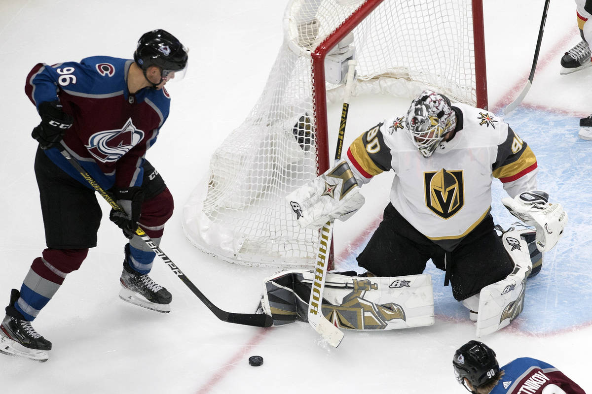 Colorado Avalanche's Mikko Rantanen (96) is stopped by Vegas Golden Knights goalie Robin Lehner ...