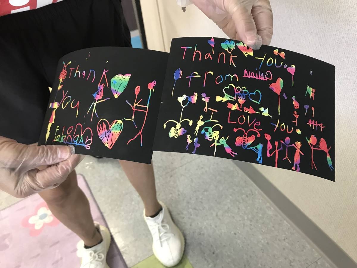 Barbara Garcia holds up two thank you cards she received from foster children on Sunday. (Photo ...