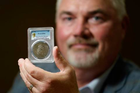 Bruce Morelan poses for a portrait holding a rare 1794 U.S. silver dollar, said to be among the ...