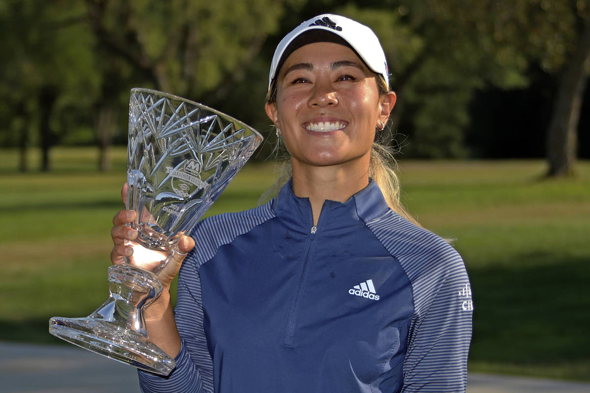 Danielle Kang poses with the trophy for winning the Marathon Classic LPGA golf tournament Sunda ...