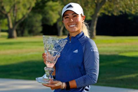 Danielle Kang poses with the trophy after winning the Marathon Classic LPGA golf tournament Sun ...