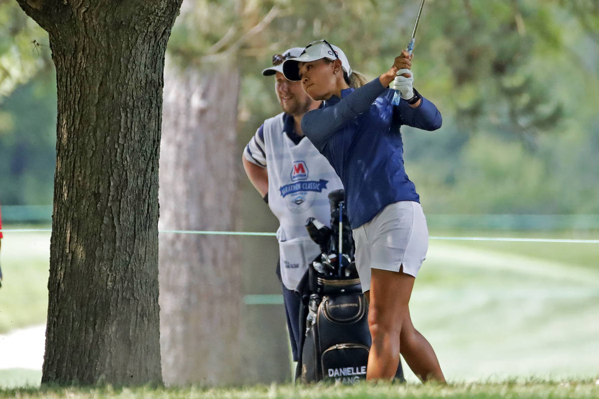 Danielle Kang hits from under a tree on the fifth fairway during the final round of the Maratho ...