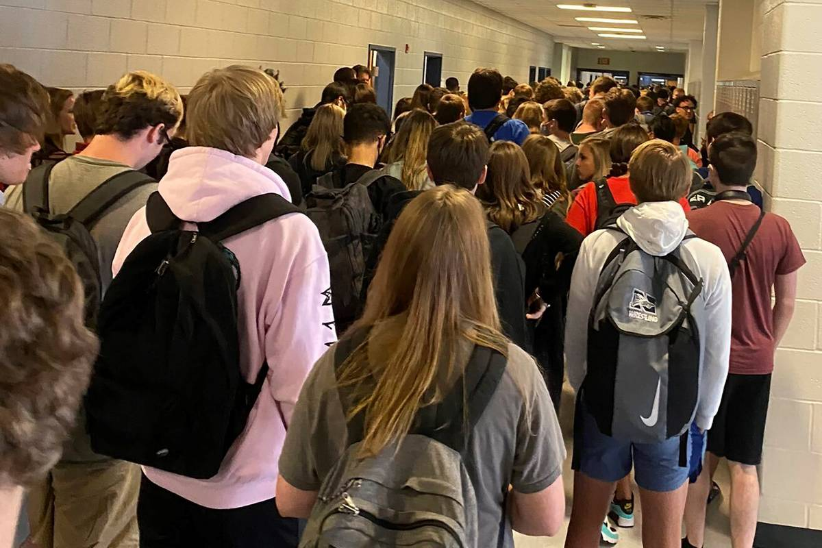 Students crowd a hallway, Tuesday, Aug. 4, 2020, at North Paulding High School in Dallas, Ga. ...