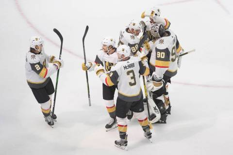 Vegas Golden Knights celebrate an overtime win over the Colorado Avalanche in an NHL hockey pla ...
