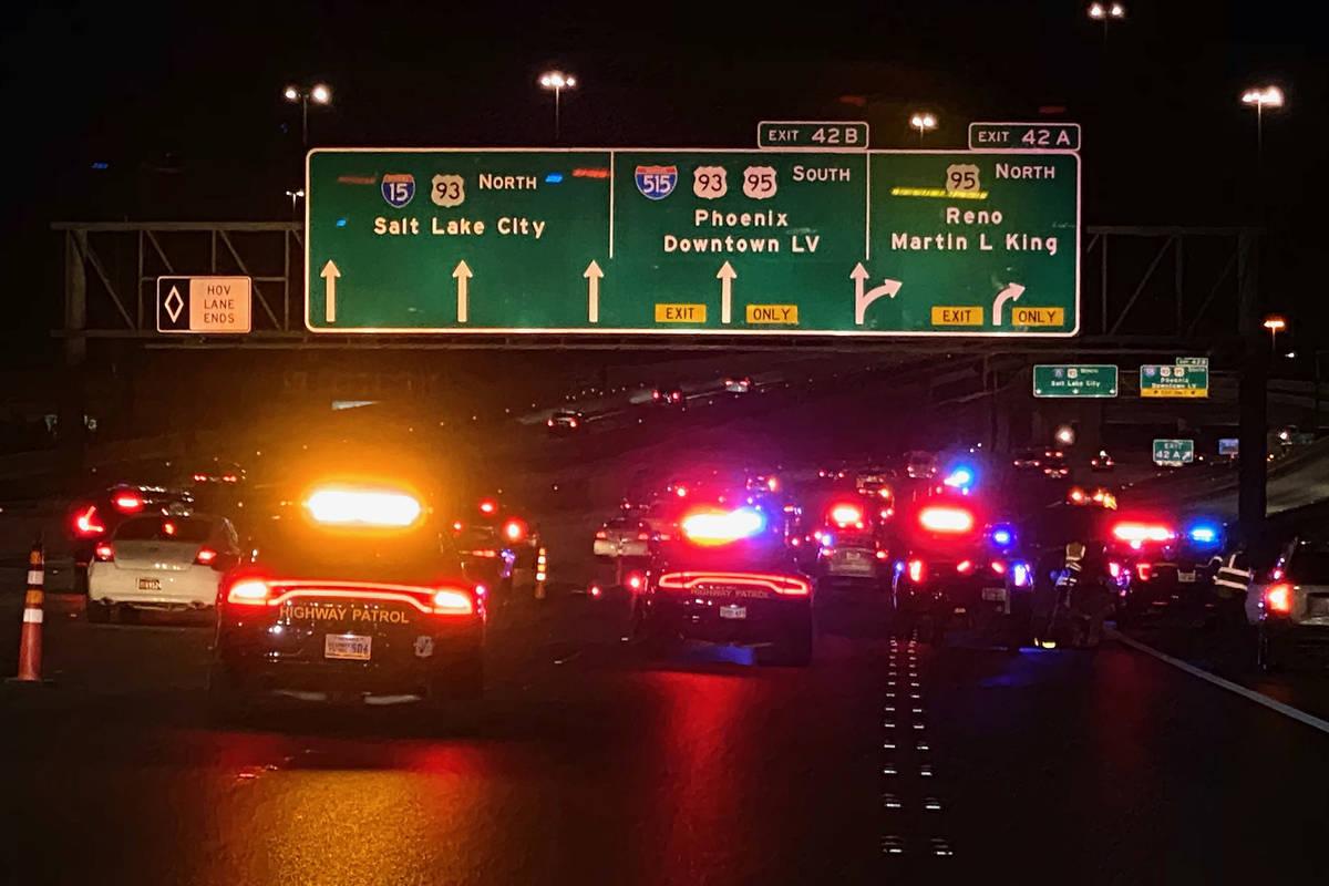 The Nevada Highway Patrol blocks part of northbound Interstate 15 near downtown Las Vegas on Su ...