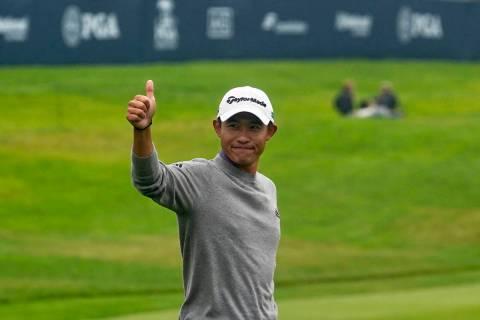 Collin Morikawa celebrates after winning the PGA Championship golf tournament at TPC Harding Pa ...
