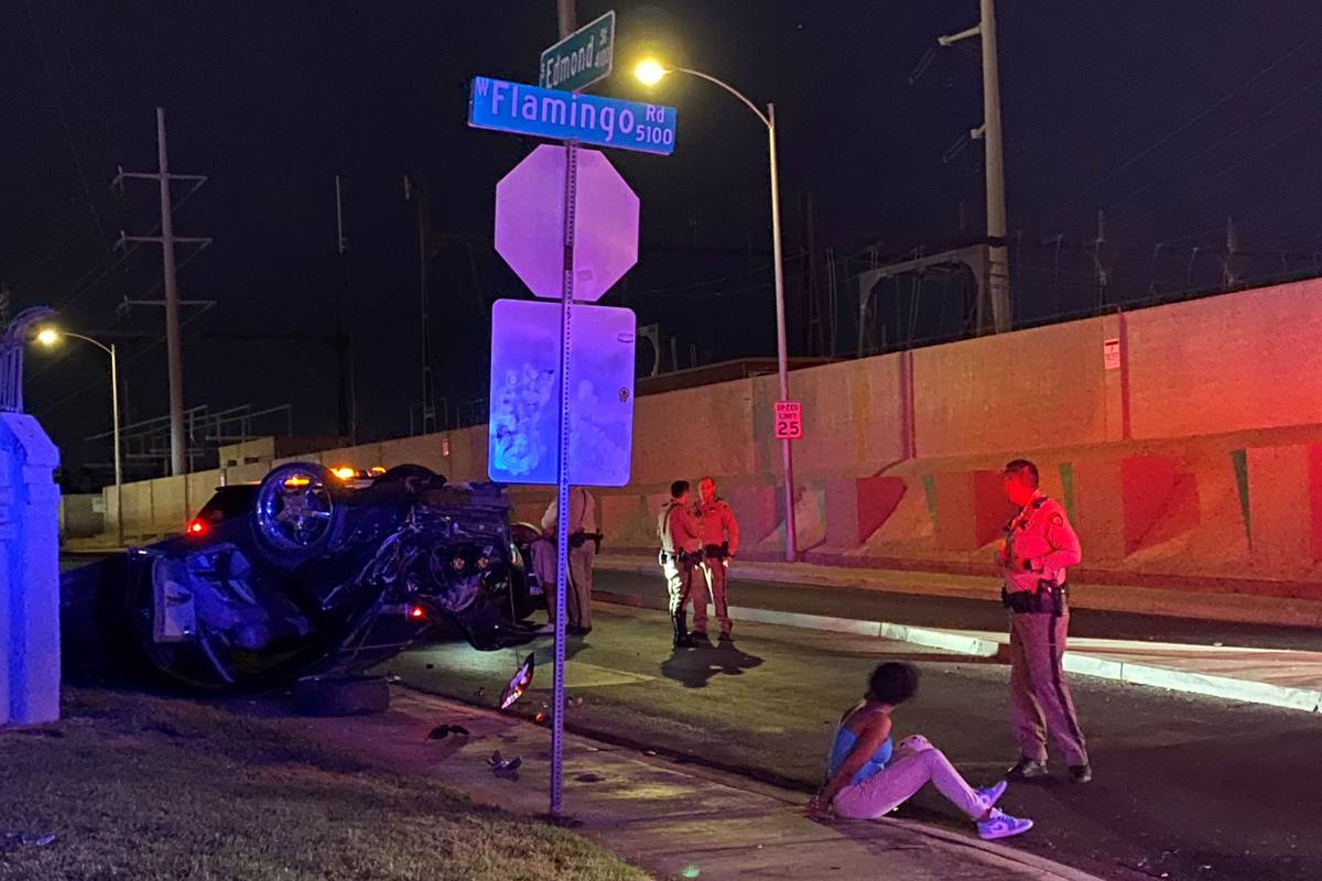 Las Vegas police investigate a rollover crash at the intersection of West Flamingo Road and Edm ...