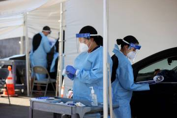 UNLV Medicine certified medical assistants test curbside for COVID-19 at the school in Las Vega ...