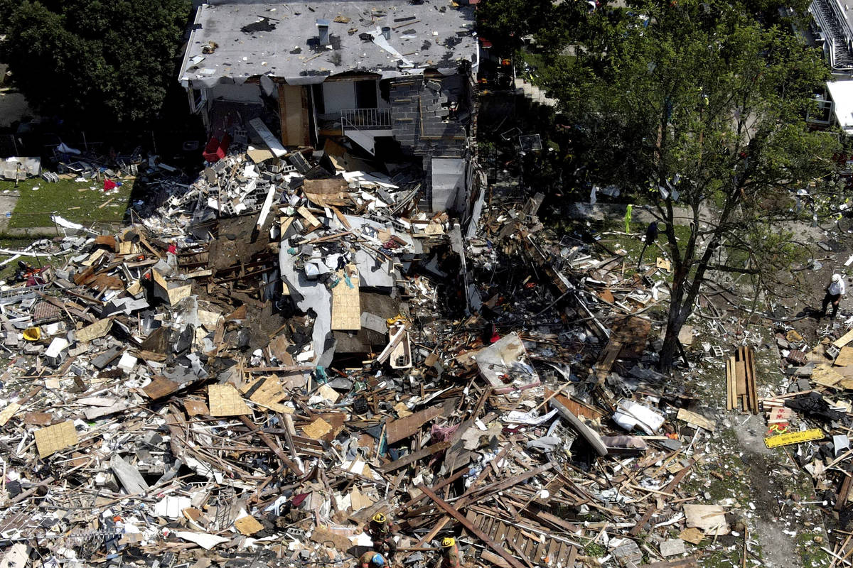 Debris and rubble covers the ground in the aftermath of an explosion in Baltimore on Monday, Au ...