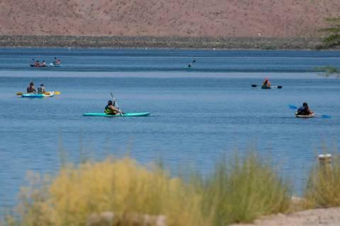 People enjoy paddle boarding at Lake Las Vegas on Monday, July 6, 2020, in Henderson. The Monda ...