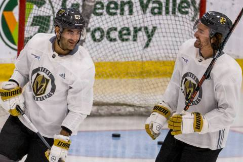 Vegas Golden Knights left wing Max Pacioretty (67, left) talks with right wing Mark Stone (61) ...