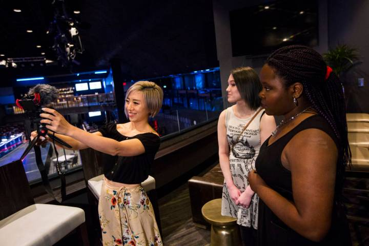 Cosplayer and influencer Stella Chuu, left, records video with grant recipients Giselle Colon, ...