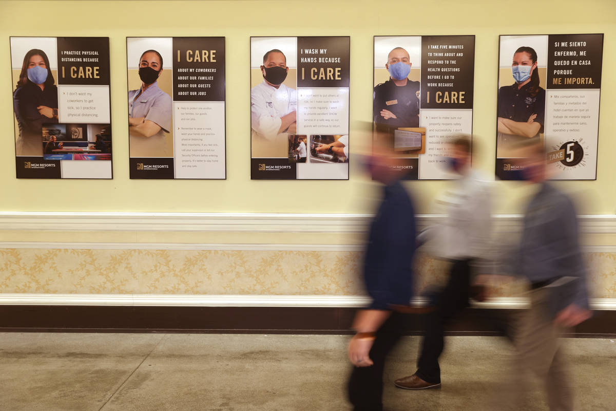 Posters in an employee area at the Bellagio in Las Vegas Tuesday, Aug. 4, 2020. The posters are ...