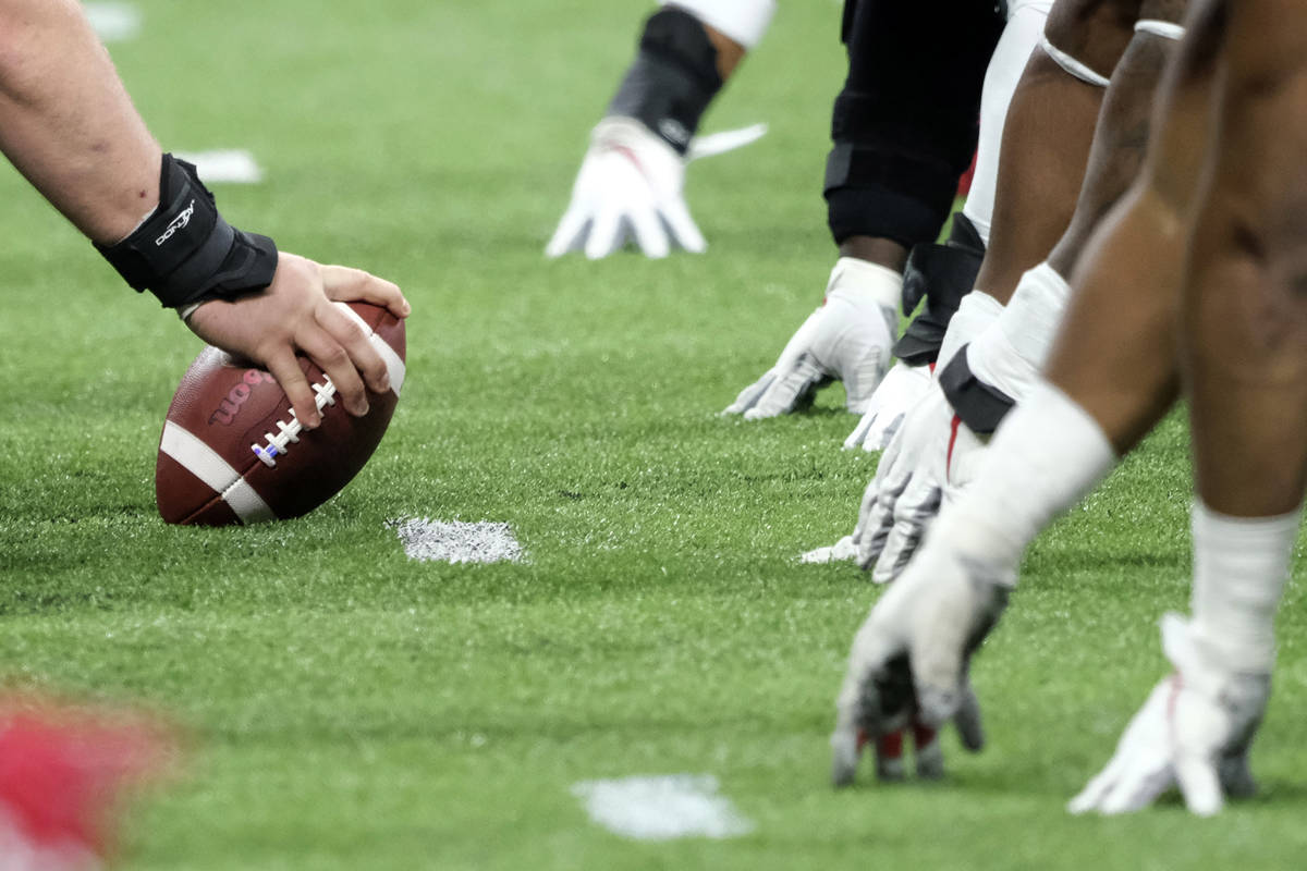 In this Dec. 7, 2019, file photo, a player prepares to hike the ball at the line of scrimmage d ...