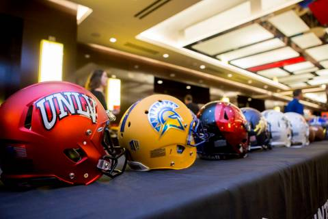 Helmets representing teams in the Mountain West devision at the Mountain West Football Media Su ...