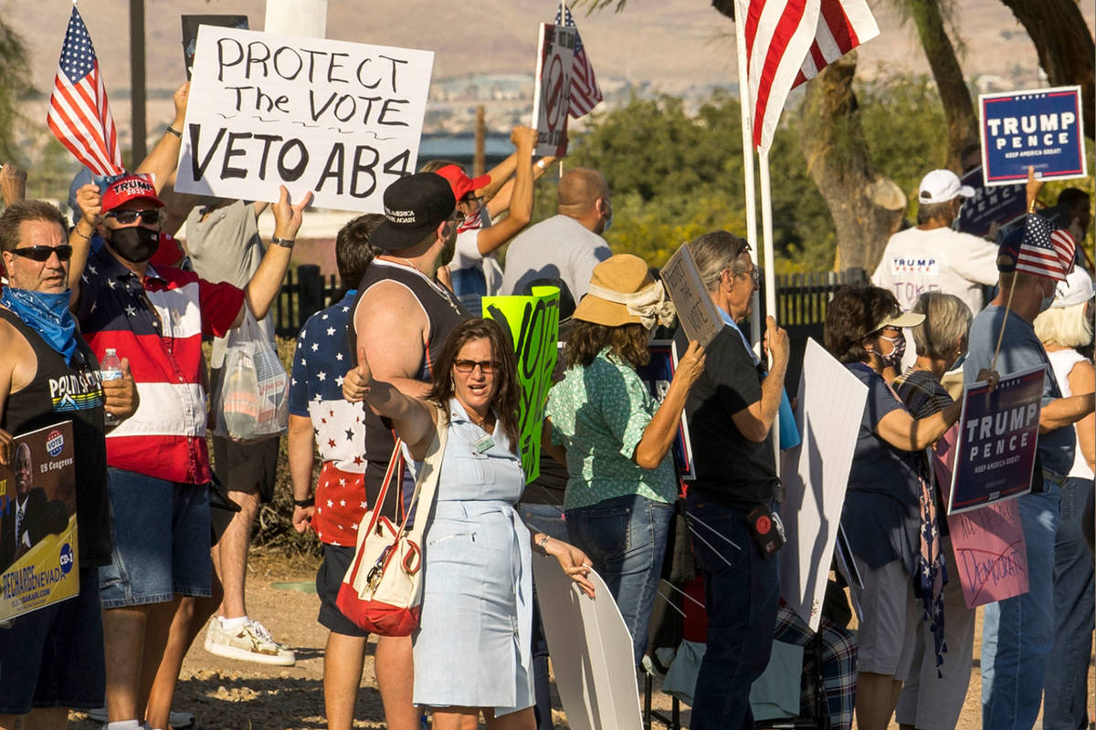 Protesters rally outside the Grant Sawyer building to voice opposition against AB4, a controver ...
