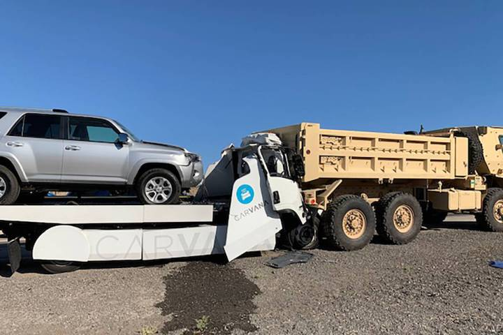The driver of a white Isuzu tow truck carrying a silver SUV was killed Monday, Aug. 10, 2020, a ...