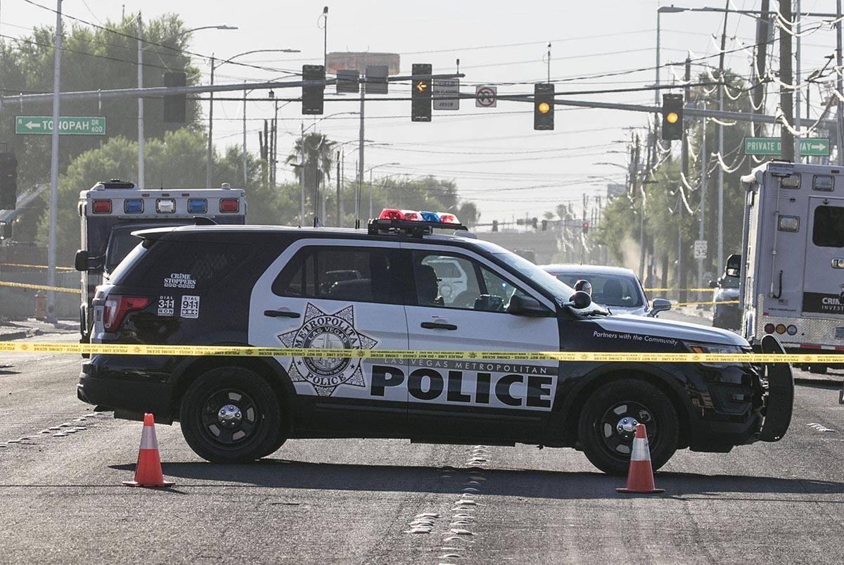The Metropolitan Police Department investigates after a gun battle broke out leaving one man de ...