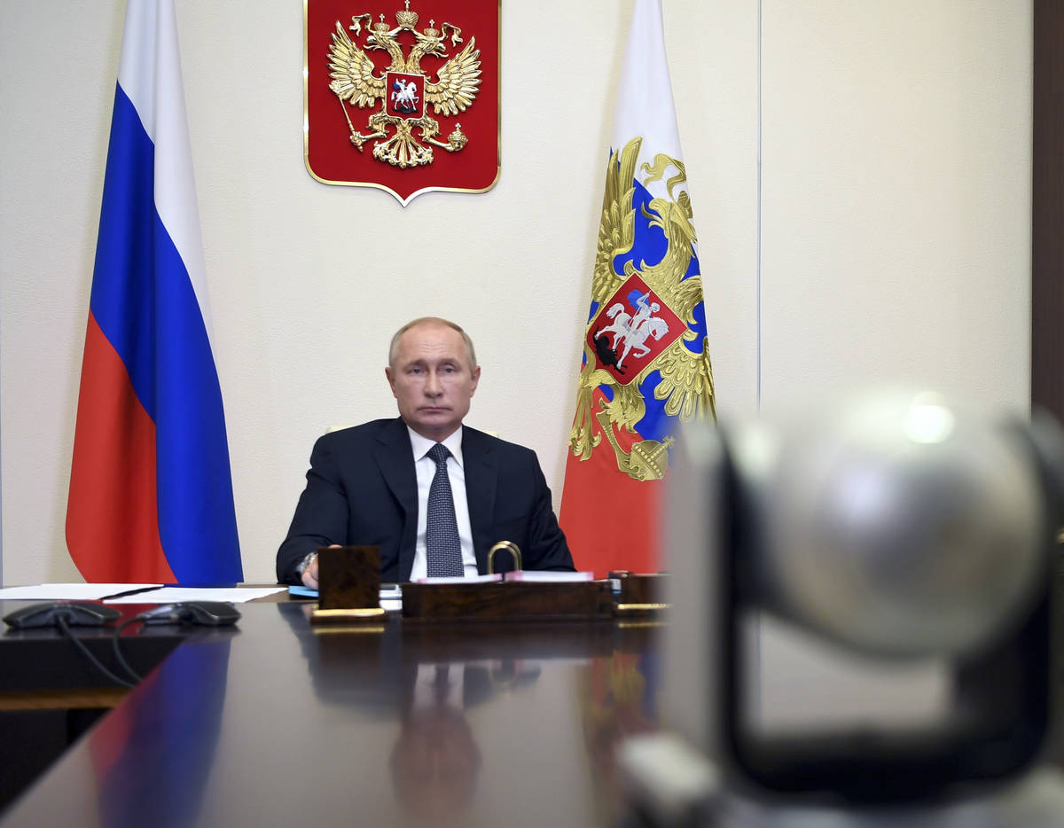 Russian President Vladimir Putin attends a cabinet meeting at the Novo-Ogaryovo residence outsi ...