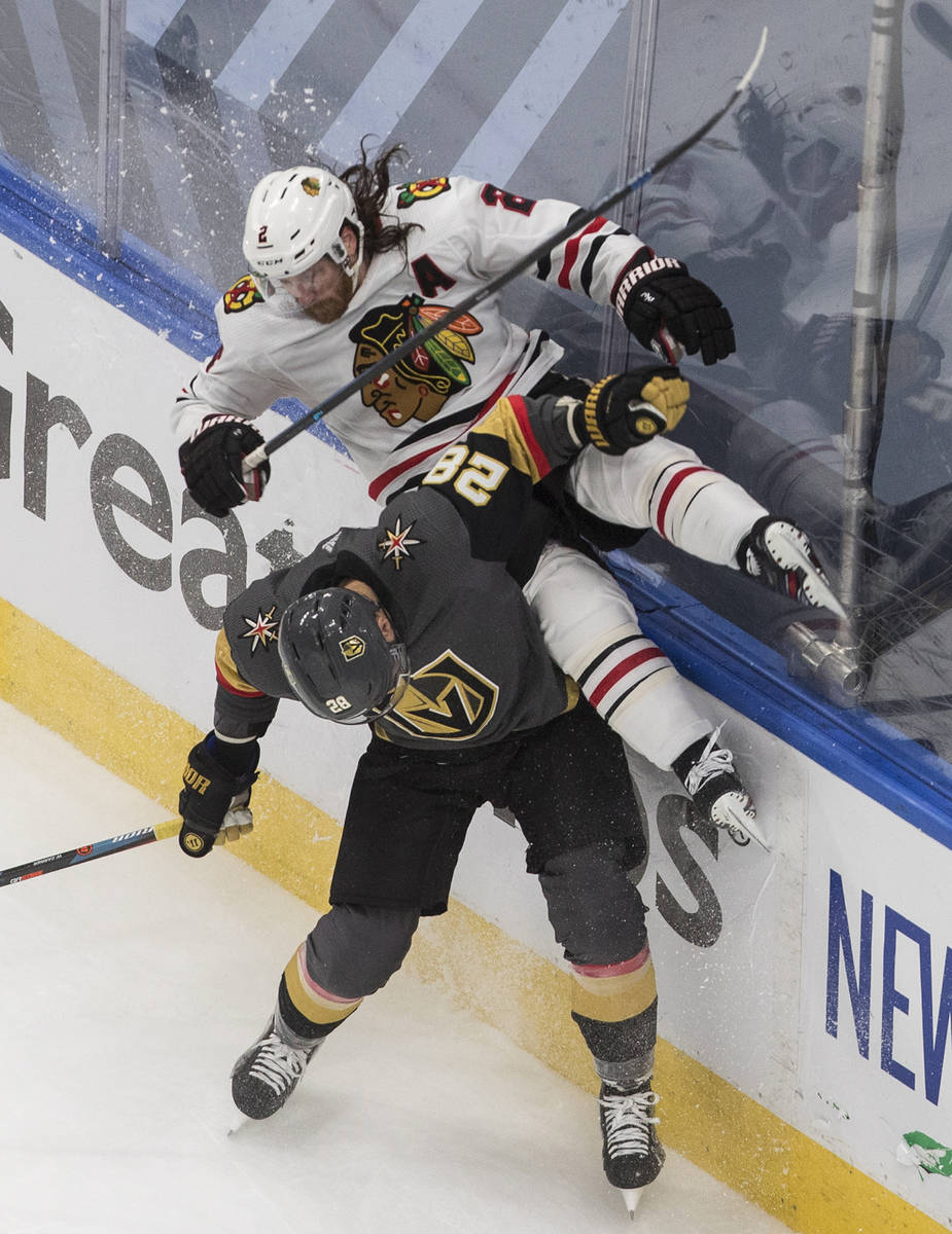 Chicago Blackhawks' Duncan Keith (2) is checked by Vegas Golden Knights' William Carrier (28) d ...