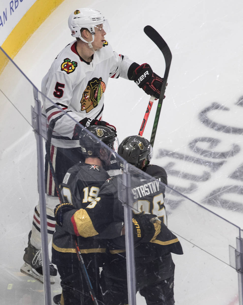 Chicago Blackhawks' Connor Murphy (5) skates by as Vegas Golden Knights' Reilly Smith (19) and ...
