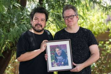 Isaias Urrabazo, left, and his husband, Steven Fehr, hold a photo of Maria Urrabazo, Isaias&#x2 ...