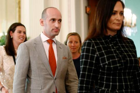 White House senior adviser Stephen Miller, center, walks into the East Room of the White House ...