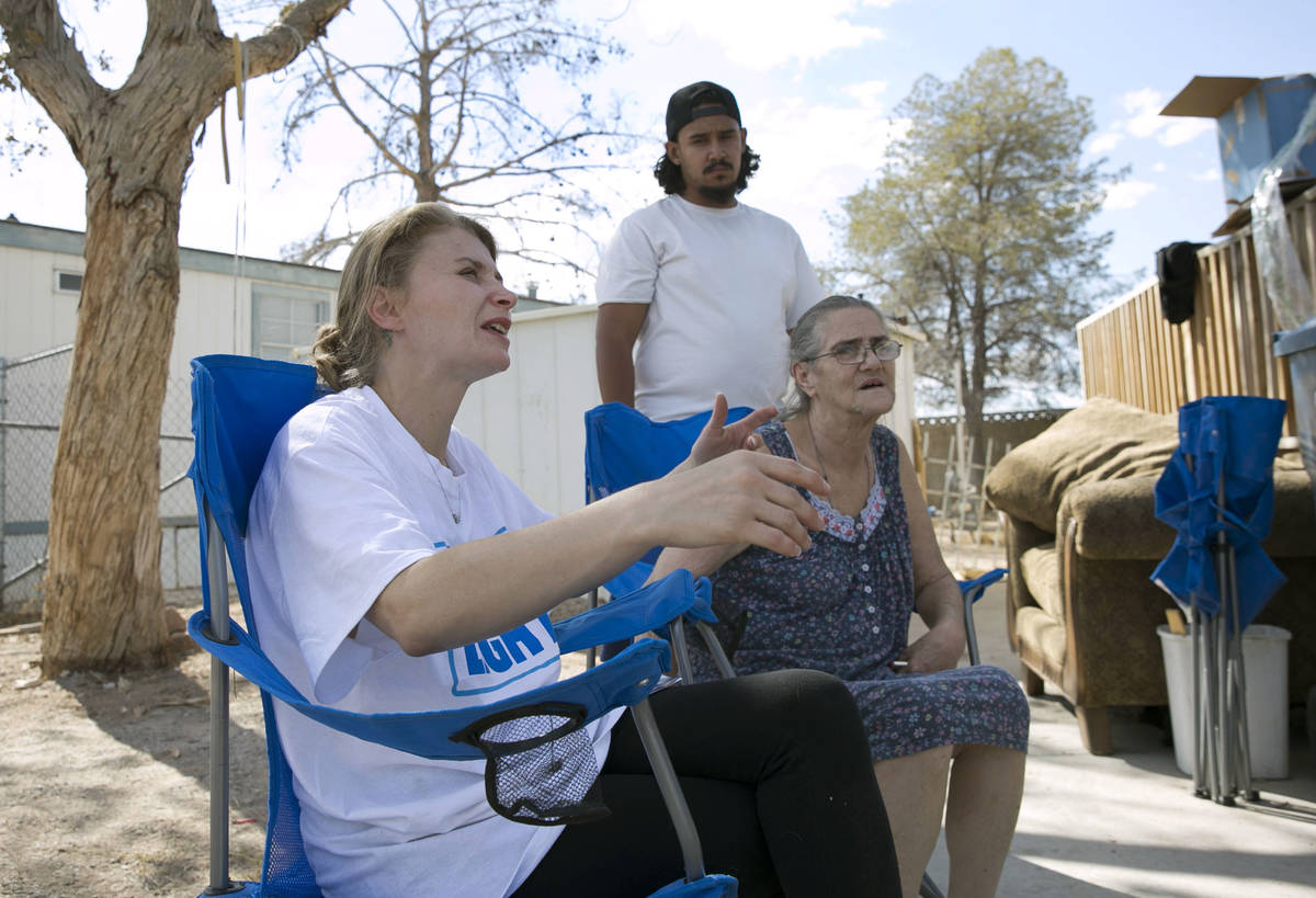 Samantha Squires, left, speaks about her brother, Joshua, who was killed by police after he hel ...