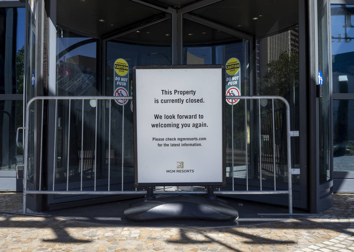 A sign stating Park MGM's temporary closure is seen along the Las Vegas Strip on Wednesday, Aug ...