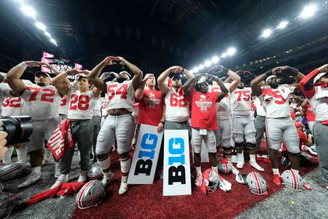 FILE - In this Dec. 8, 2019, file photo, Ohio State players celebrate the team's 34-21 win over ...
