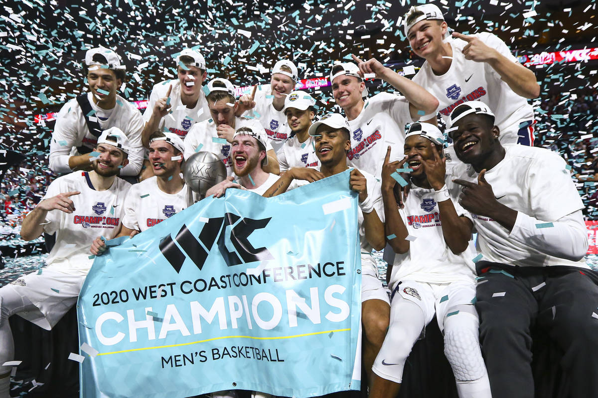 Gonzaga players celebrate after defeating St. Mary's to win the West Coast Conference tournamen ...