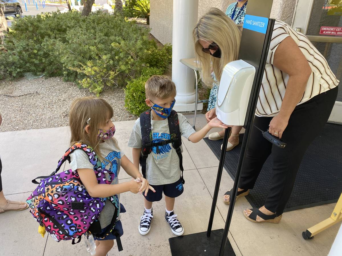 Students arrive for the first day of school Wednesday, Aug. 12, 2020 at the Dr. Miriam & Sheldo ...