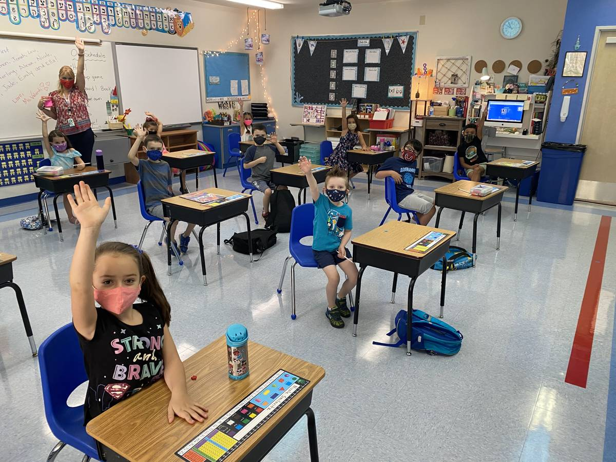 Students participate in class on the first day of school Wednesday, Aug. 12, 2020 at the Dr. Mi ...