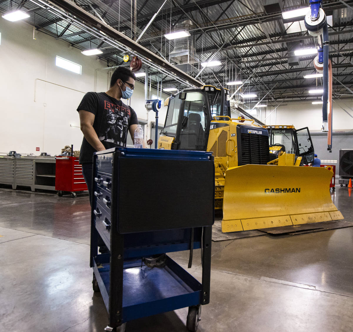 Student Samuel Branch, of Henderson, moves a tool cart during a diesel hydraulics class at the ...