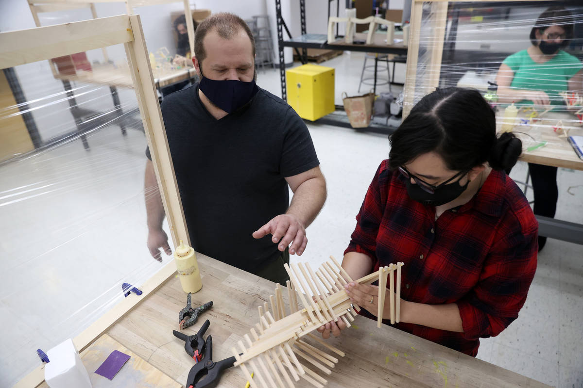 Raquel Cortez, 19, right, receives assistant from her art teacher Dave Rowe during an art class ...