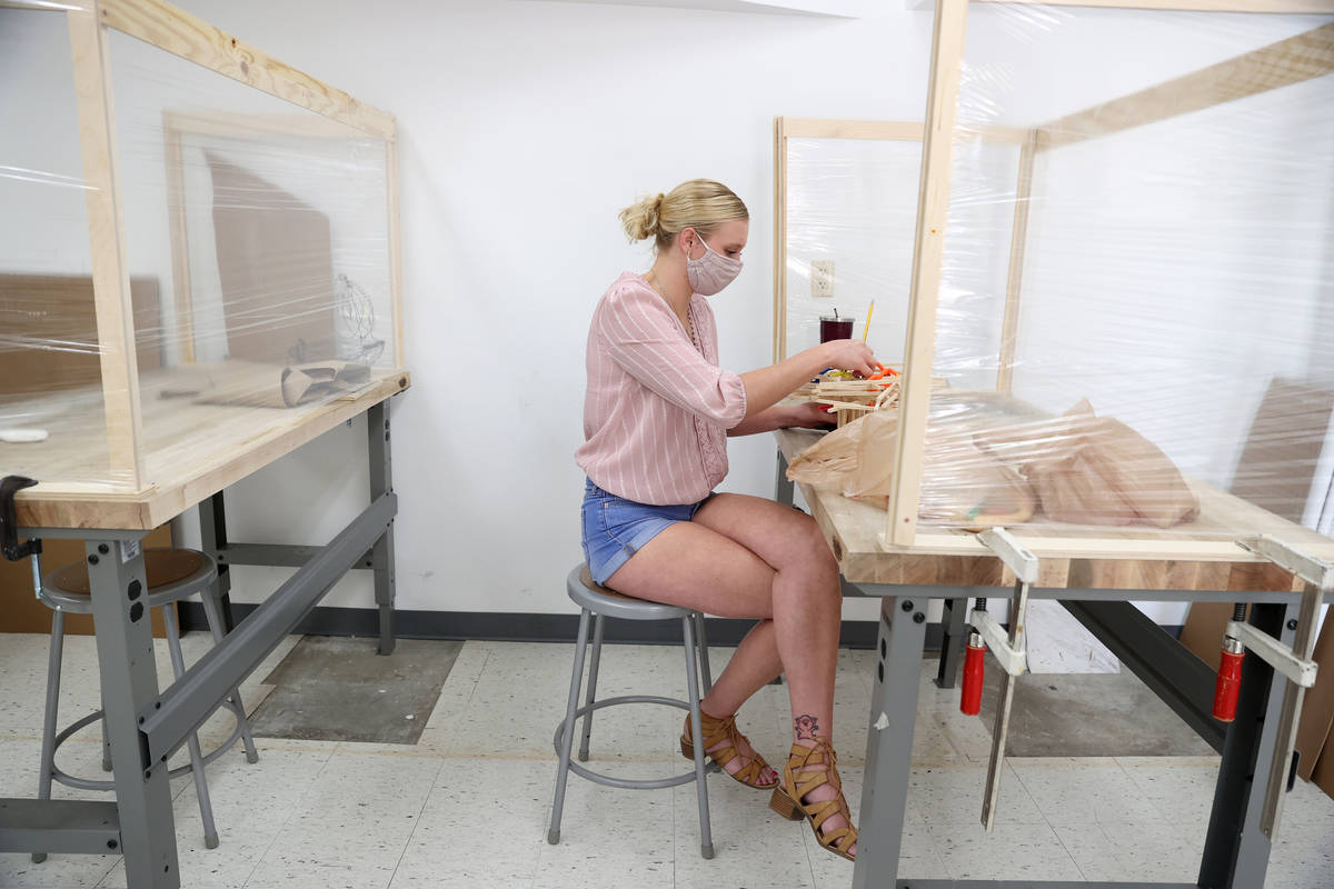 Azure Werner, 21, builds an analog model during her class at UNLV in Las Vegas, Thursday, Aug. ...